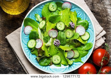 Fresh Green Salad On Wooden Background