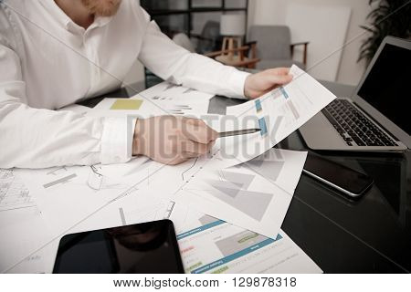 Investment manager working process.Photo bank trader work market analyze.Using electronic devices.Work worldwide stock exchanges report documents.Business project startup.Horizontal, film effect.