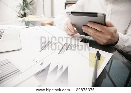 Risk manager working process.Photo trader work modern tablet.Touching electronic device.Graphic, stock exchange rating, reports document table.Business project startup.Horizontal, film effect.