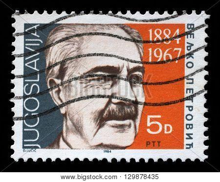 ZAGREB, CROATIA - JUNE 21: a stamp printed in Yugoslavia shows the 100th Anniversary of the Birth of Veljko Petrovic, Serbian poet, circa 1984, on June 21, 2014, Zagreb, Croatia
