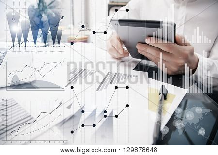 Banker Working Process.Photo Analyst Trader work Market Charts.Using Electronic Devices.Graphic Icons, Worldwide Online Stock Exchanges Interfaces on Screen.Business Project Startup.Film Effect.