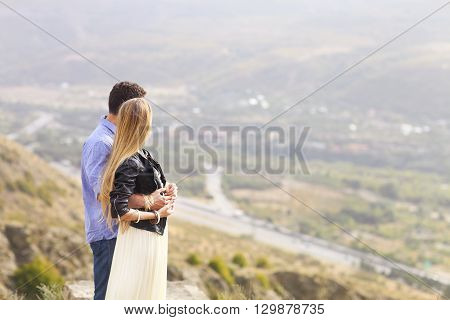 Beautiful happy smiling couple embracing outdoors nature
