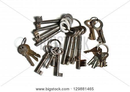 many old keys on keyrings on white background