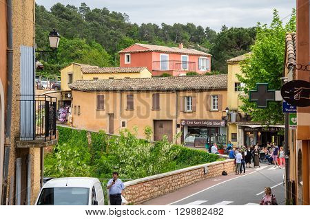 ROUSSILLON FRANCE - MAY 03 2015: Street of medieval village of Roussillon. It ochre village is included in list of