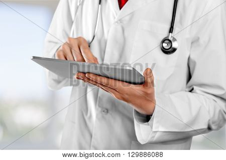 Doctor using tablet.