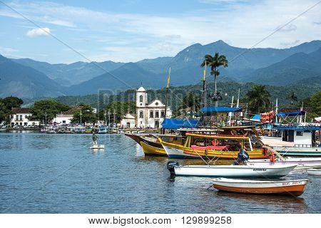 RIO DE JANEIRO FEBRUARY 15 2016 - Tourist boats waiting for tourists near the Church Igreja de Santa Rita de Cassia in Paraty state Rio de Janeiro Brazil