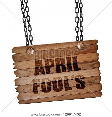 april fool's, 3D rendering, wooden board on a grunge chain