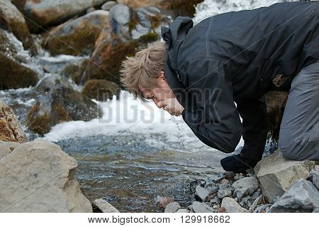 Drinking water from a pure mountain stream