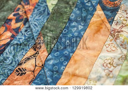 Patchwork quilt. Part of patchwork quilt as background. A blanket in style patchwork. Color blanket. Handmade.