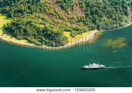 Tourist Ship Are Sailing Between Fjords. Amazing Nature Of Norwegian Mountains In Sognefjord. Nature Of Norway. Travel Concept. Scenic View From Mountain Top.