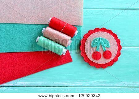 Felt brooch hand embroidered summer. Beautiful handmade felt brooch. Idea of children's art. Felt cherry ornament. Kids craft idea