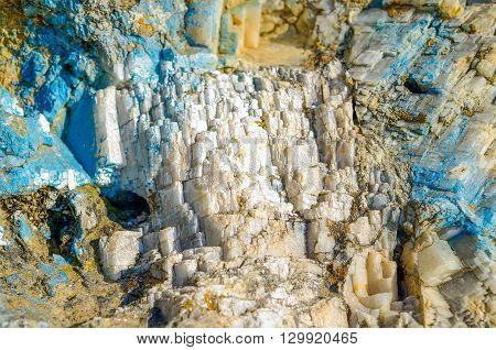 Shining in the sun quartz mountain. Blue streaks. Mica.