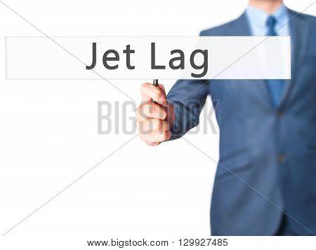 Jet Lag - Businessman Hand Holding Sign