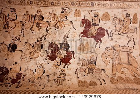 ORCHHA, INDIA - DEC 21, 2012:Indian warlike horsemen on the mural at Lakshmi Narayana Temple on December 21, 2012 in Orchha, India. The temple was built by King Veer Singh of the Bundela dynasty in 1622
