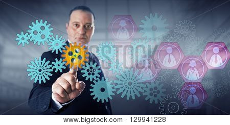 Male entrepreneur is highlighting a virtual cog via touch. Concept for business process innovation the mechanics of workforce management and control of information technology service operation.