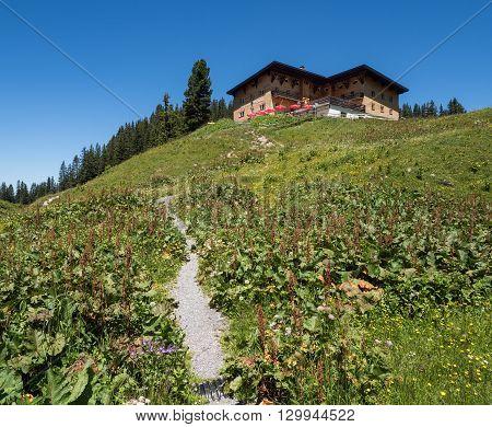 SCHROECKEN AUSTRIA JUNE 30: A view of Berghotel Koerbersee at the top of hill near village Schroecken in Bregenzerwald region Vorarlberg in Austria 2015.