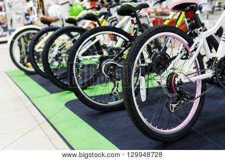 Row of the mountain mtb bicycles in the sports store, bike shopping