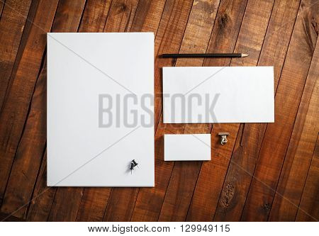 Blank corporate identity template on wooden table background. Photo of blank stationery set. Mockup for design presentations and portfolios. Top view.