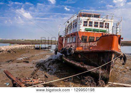 Seixal, Portugal. September 09, 2015: Cacilheiro, a traditional Tagus river ferry that connects Lisbon to the South-Margin in a shipyard.