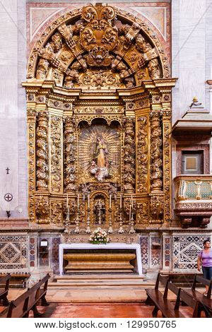 Santarem, Portugal. September 10, 2015: Baroque gilded chapel dedicated to Our Lady in the interior of the Santarem See Cathedral aka Nossa Senhora da Conceicao Church. 17th century Mannerist style.