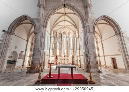 Santarem, Portugal. September 11, 2015: Altar, apse and chapels of the Santo Agostinho da Graca church. 14th and 15th century Mendicant and Flamboyant Gothic Architecture.