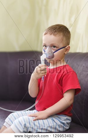 Small Boy Does Therapeutic Inhalation