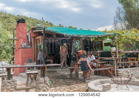 DE VLUGT SOUTH AFRICA - MARCH 5 2016: Unidentified people at a well known landmark on the Prince Alfred Pass Angies G-spot (short for Angies Great Spot) which offers a restaurant and accommodation