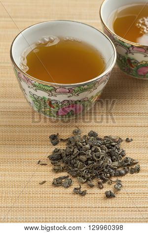 Two cups with green gunpowder tea