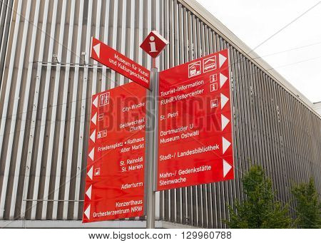 touristic red signpost in the center of Dortmund Germany