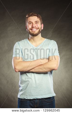Portrait of happy smiling handsome fashionable man in shirt. Young guy posing in studio on black. Casual fashion.