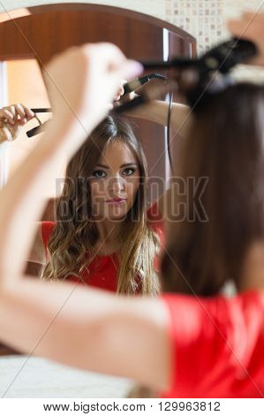 Attractive Woman Making Hairstyle.