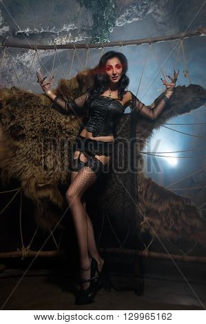 Vampire Woman. Beautiful Glamour Sexy Vampire Lady Halloween Portrait.