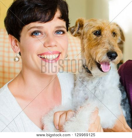 Young woman and her pet at home