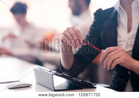 close-up of woman hands holding pen on business meeting