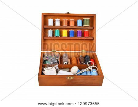 Sewing kit in wooden box isolated on white background