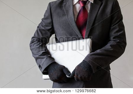 Man In Suit Is Stealing A Laptop - Data Or Information, Computer Stealing Concept