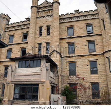 JOLIET, ILLINOIS / UNITED STATES - JANUARY 1, 2013: The front entrance of the old Illinois State Penitentiary, now vacant and abandoned.