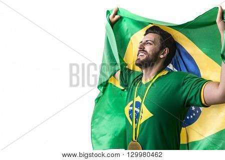 Brazilian young fan man holding the flag of Brazil on white background