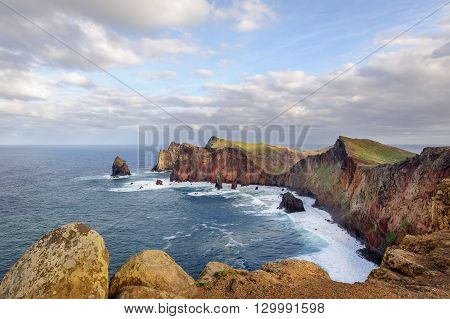 Panoramic landscape of Madeira island rocks and stones and Atlantic ocean at warm evening sun light. Madeira, Portugal.