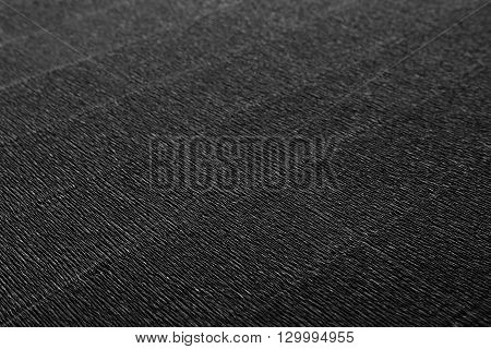 Abstract textured minimalist dark background with diagonal lines. The texture.