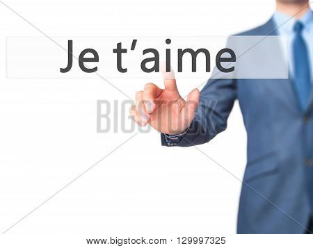 Je T'aime ( I Love You In French) - Businessman Hand Pressing Button On Touch Screen Interface.