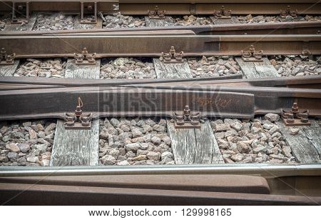 Railway track on gravel embankment. Old-fashioned mode.