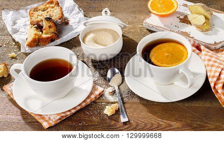 Two Cups Of Tea With Cake