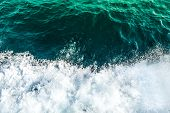 Rolling sea waves top view of ocean covered by foam turquoise and green gradient color water poster