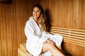 Beautiful woman relaxing in sauna and staying healthy poster