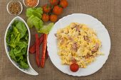 Fresh scrambled eggs with bacon and vegetables. Domestic eggs for breakfast. Breakfast athletes. Preparing eggs. Protein diet. Eggs in different kinds of preparations. poster