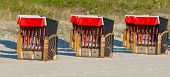 Strandkorb,  Beach chairs on beach at Binz seaside resort on Rugen Island in Germany poster