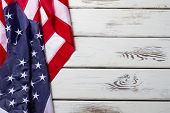 Crumpled American flag. American flag on wooden background. Banner laying on white table. Democracy and freedom. poster
