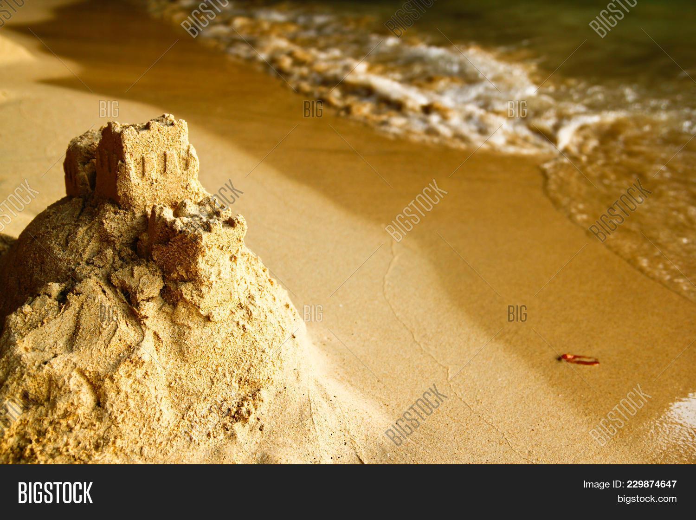 Sandcastle on the beach PowerPoint Template - Sandcastle on the ...