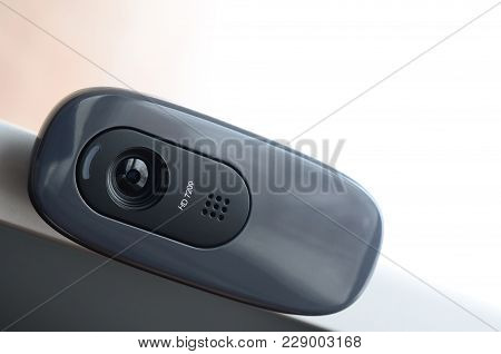 A Modern Web Camera Is Installed On The Body Of A Flat Screen Monitor. Device For Video Communicatio